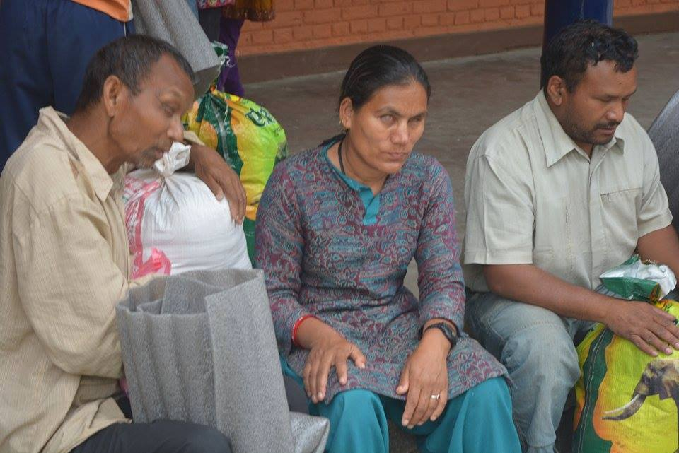 Three blind people sitting with the relief material