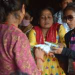 Sristi distributing milk packets