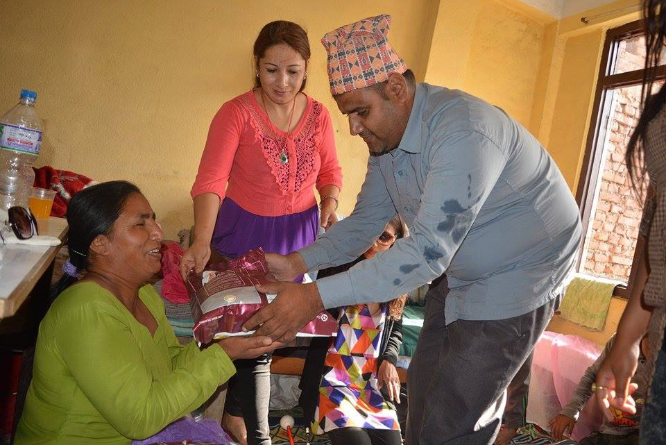 A blind Rock member is handing over food to a women