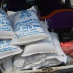 Sacs of rice being carried in a car