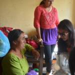 Sristi talking to a blind women at her house