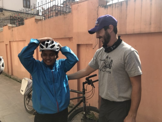 Our blind member getting ready to ride the bike